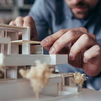 Architect making a model house